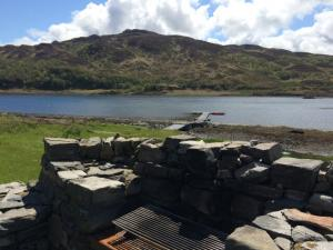 Carna Cottage Stone, hand built BBQ overlooking Loch Sunart. Perfect outdoor eating and family cooking