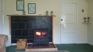 Carna cottage sitting room has a wood burning stove making it comfortable all year round
